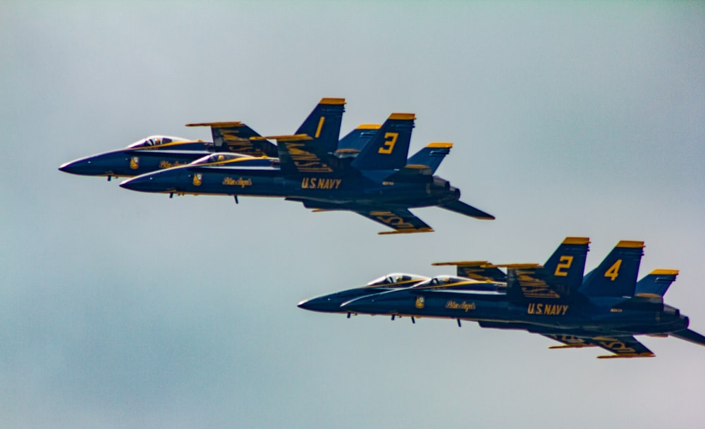 two blue-and-yellow fighter planes in the sky