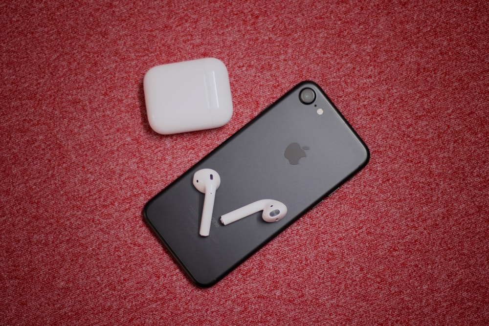 black iPhone 7 with AirPods