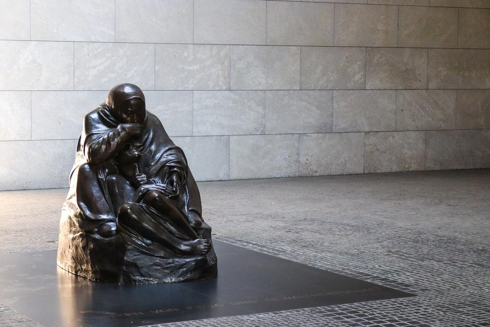 sitting man statue
