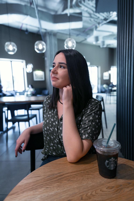 woman sitting on chair inside restaurant