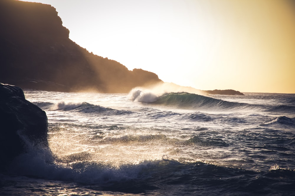 sea waves during golden hour