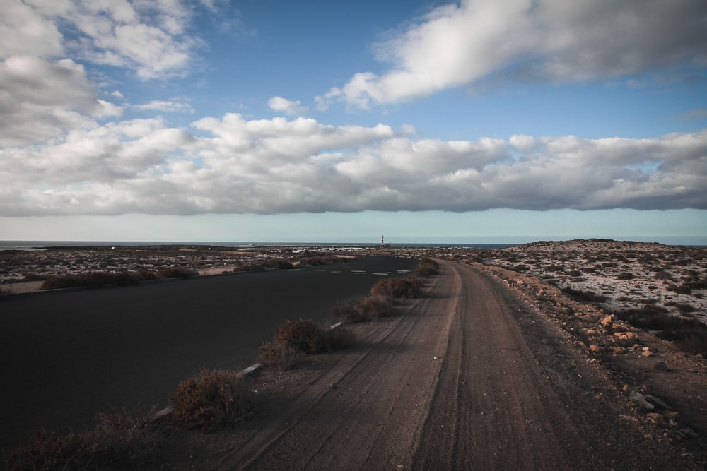 panoramic photography of empty road under white clouds