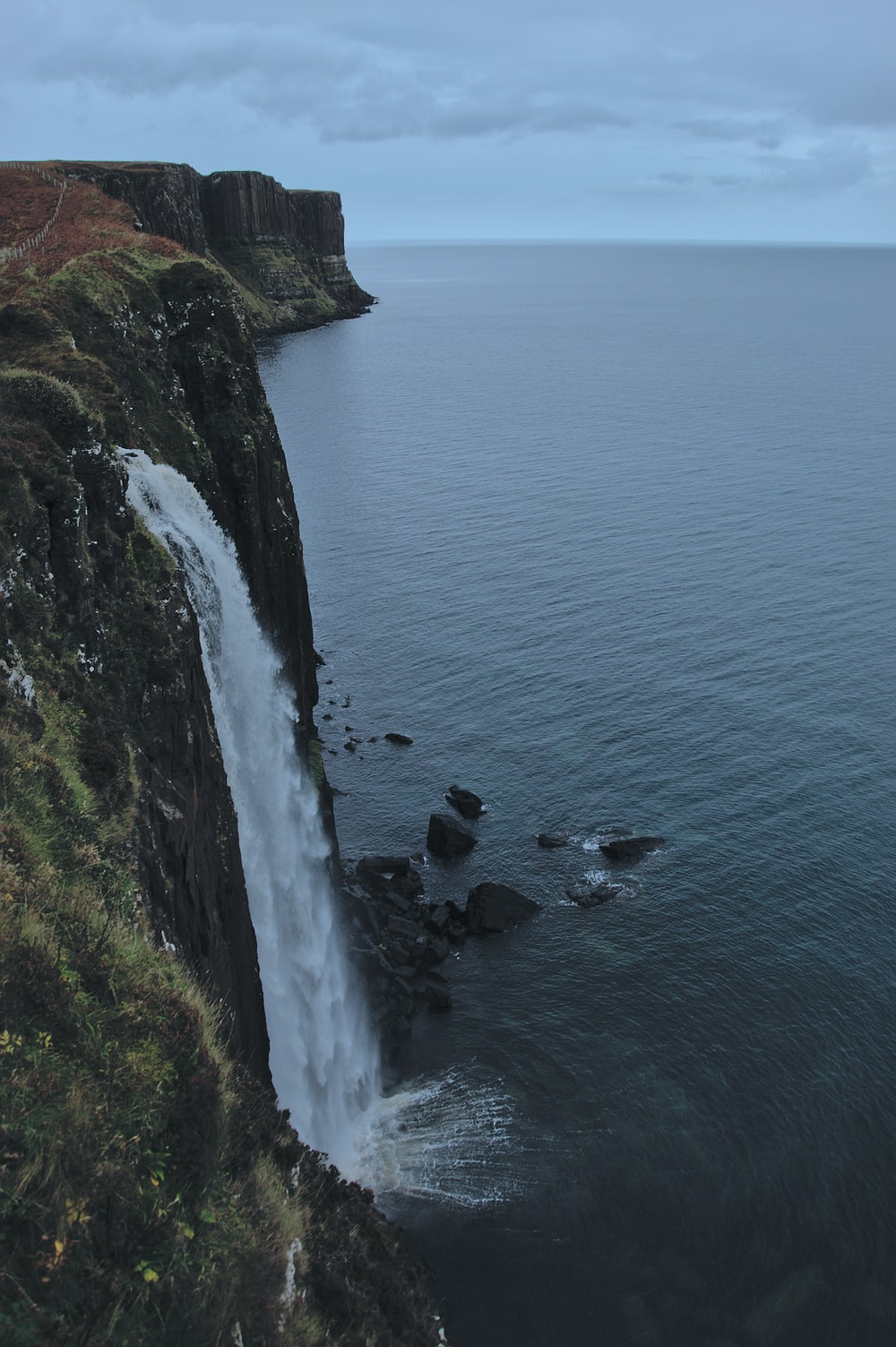 waterfalls beside sea