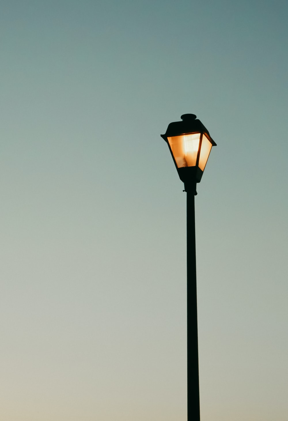 lighted black and orange lamp post