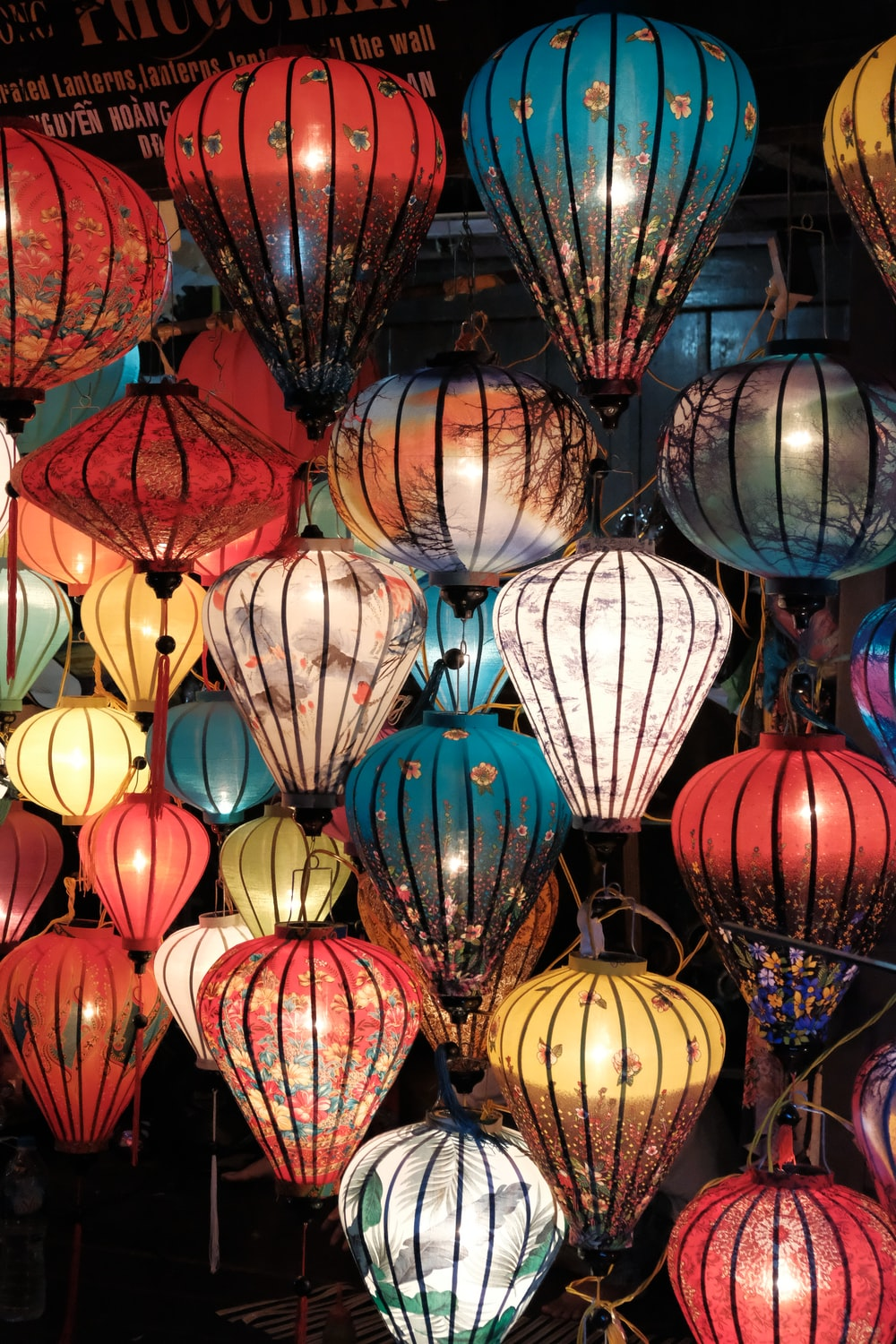 assorted-color lantern lighted in room