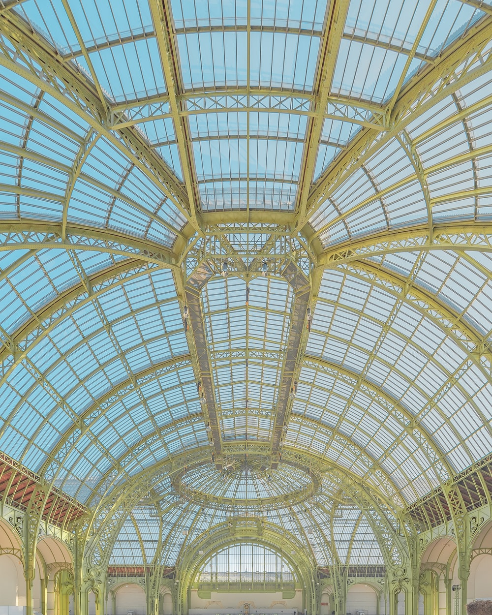 low-angle photography of glass ceiling