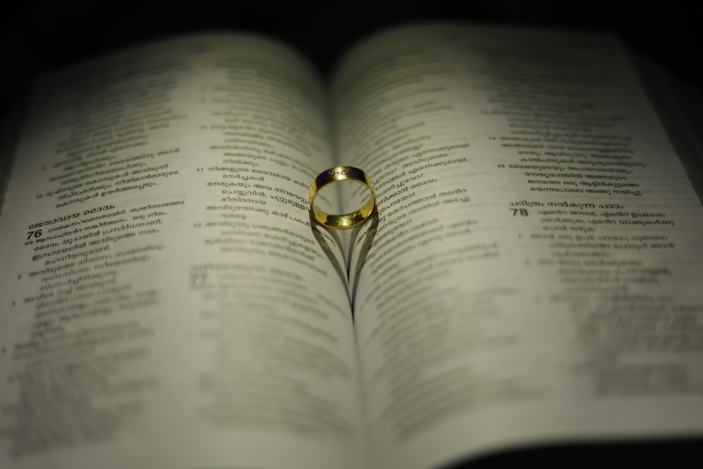 gold-colored ring on book page