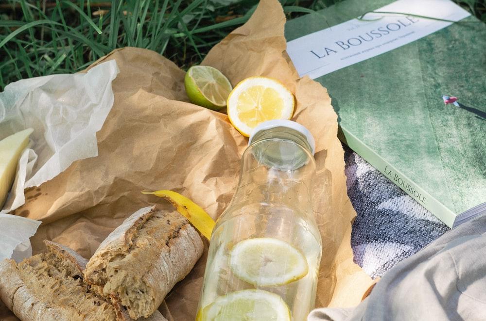 slices of lemon near glass bottle