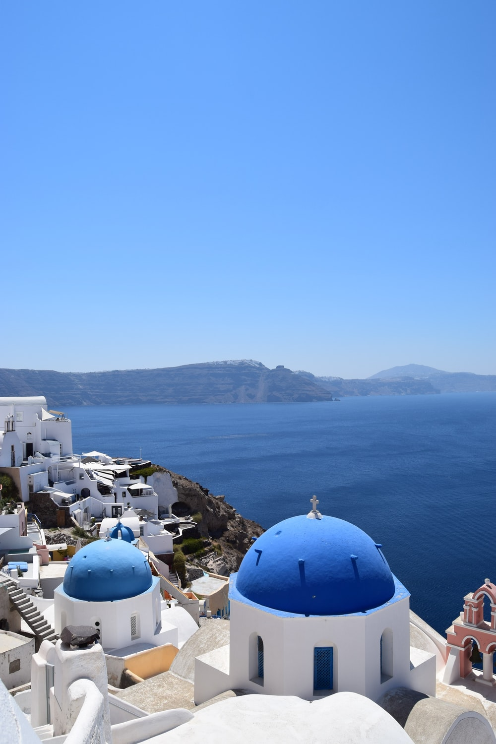 blue dome buidings in Santorini, Greece during daytime