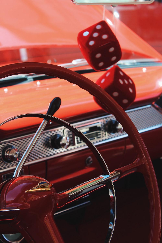 red vehicle steering wheel