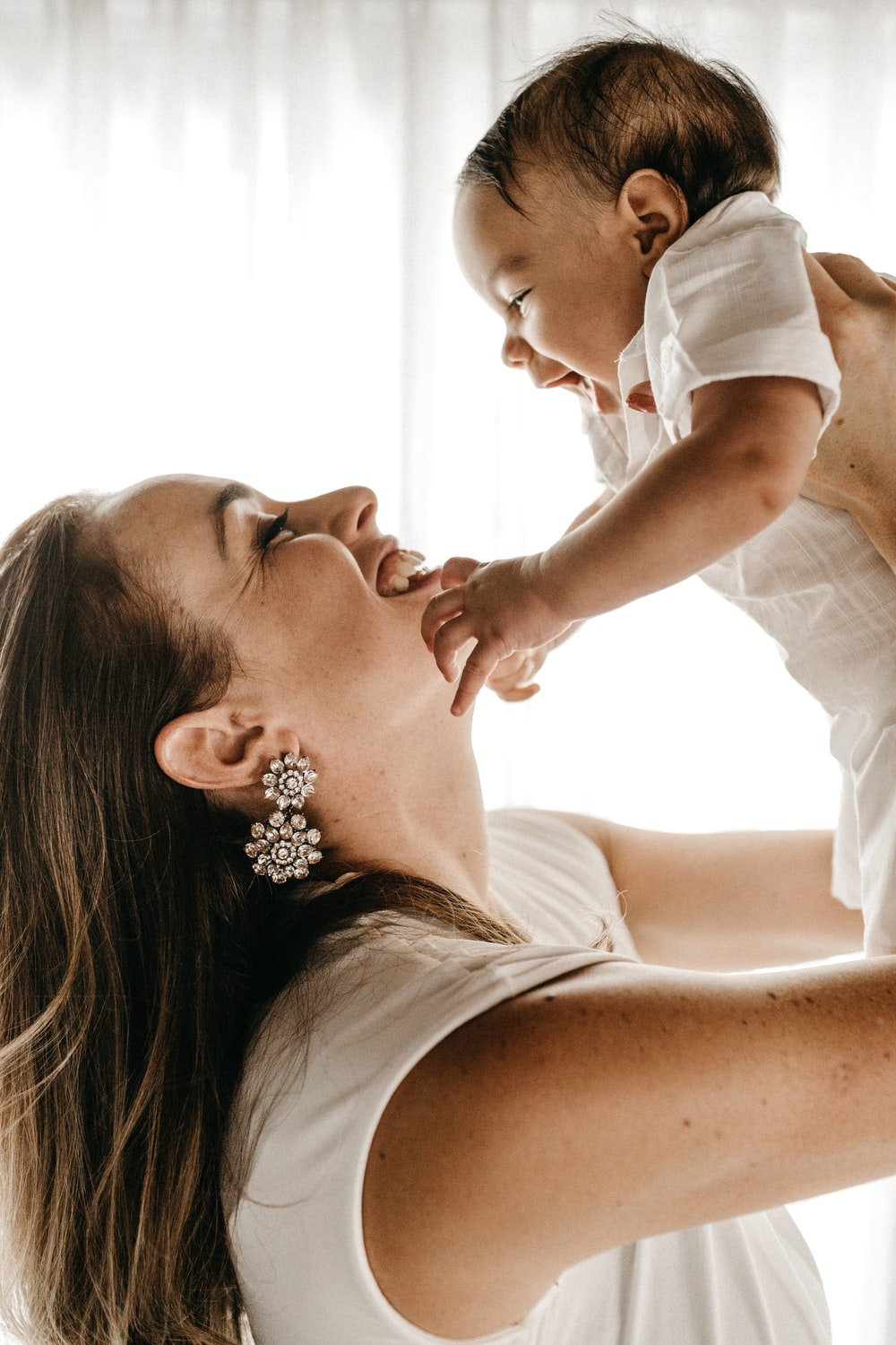 woman holding baby up