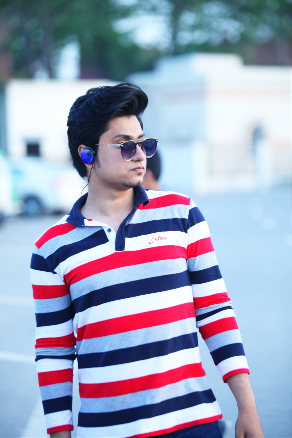 man wearing red and white striped shirt