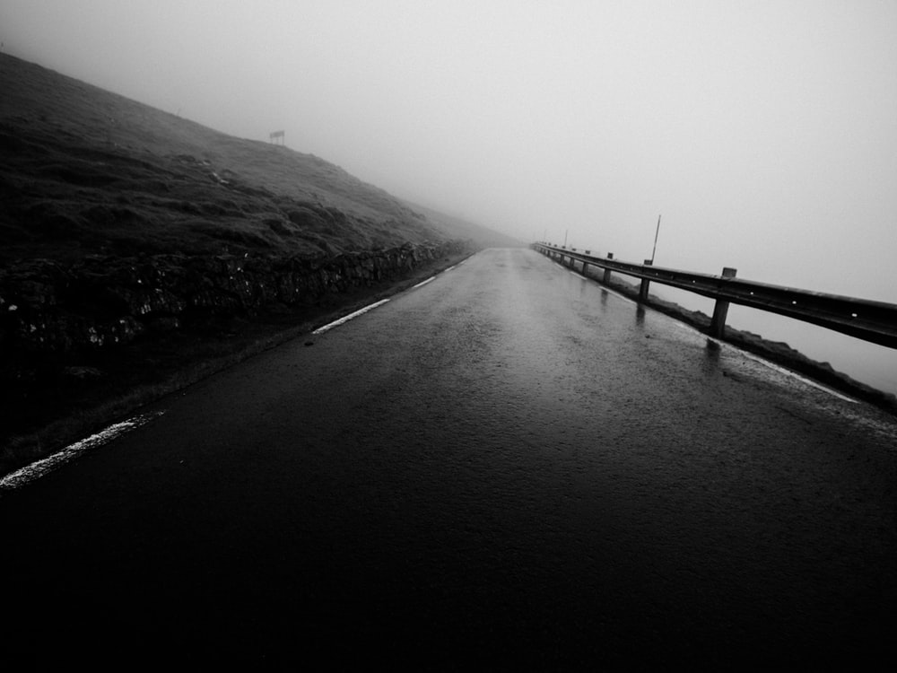 empty road in grayscale photo