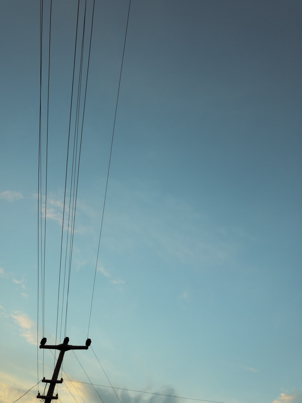 silhouette of power lines and post