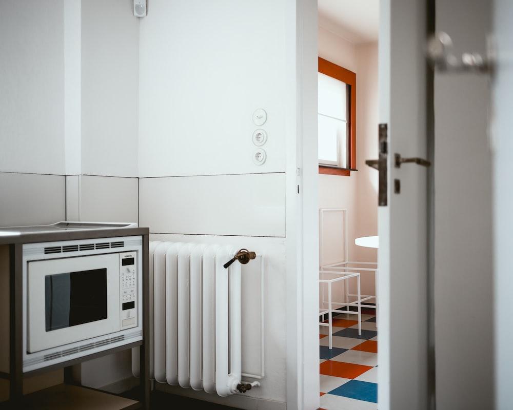 white radiator heater besides white digital vault