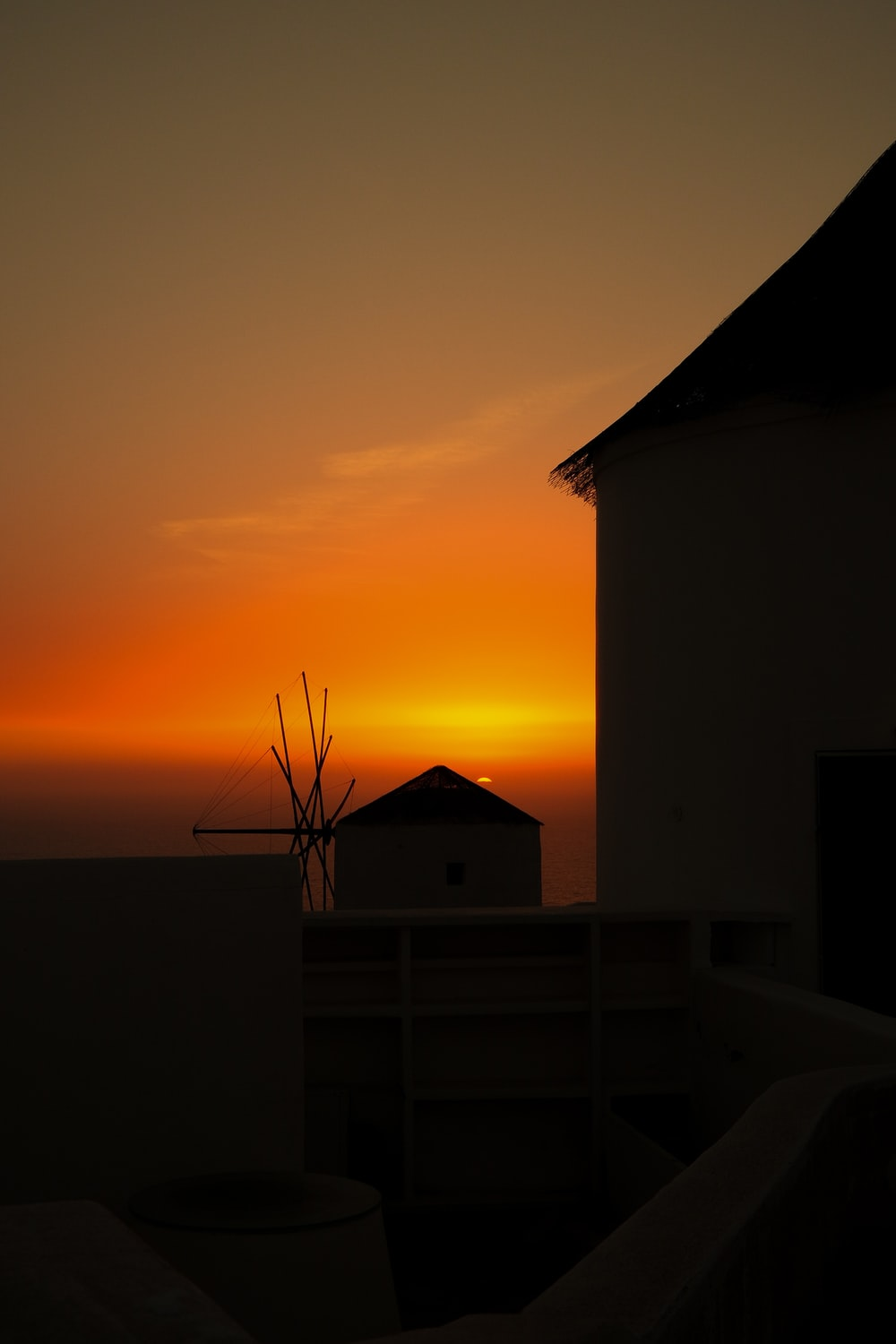 silhouette of house during golden hour