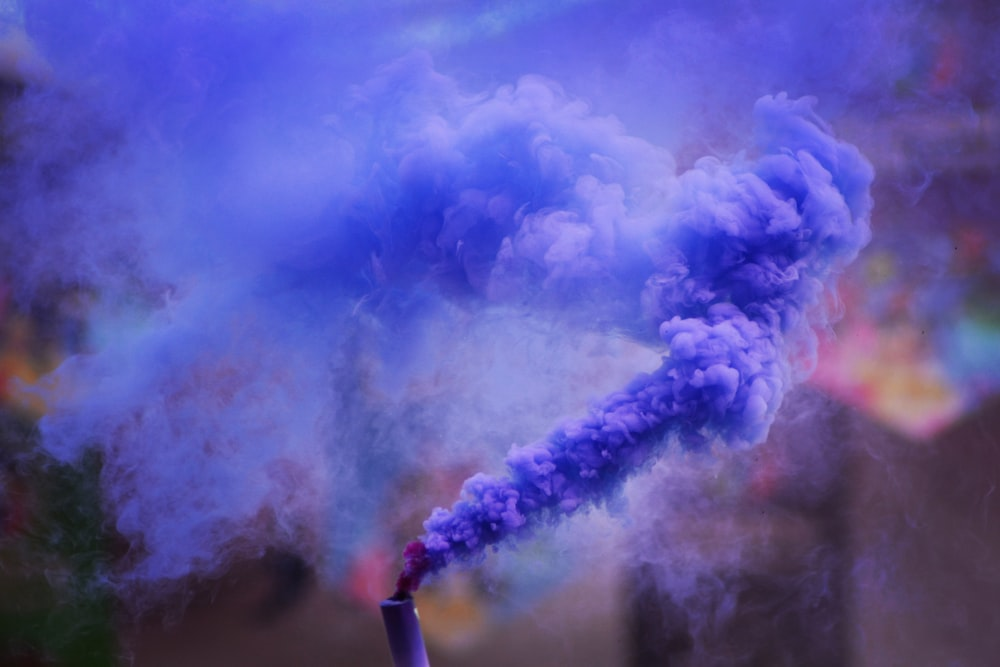 spreading blue smoke