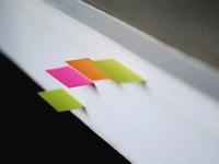 shallow focus photography of green, pink, and orange bookmarks