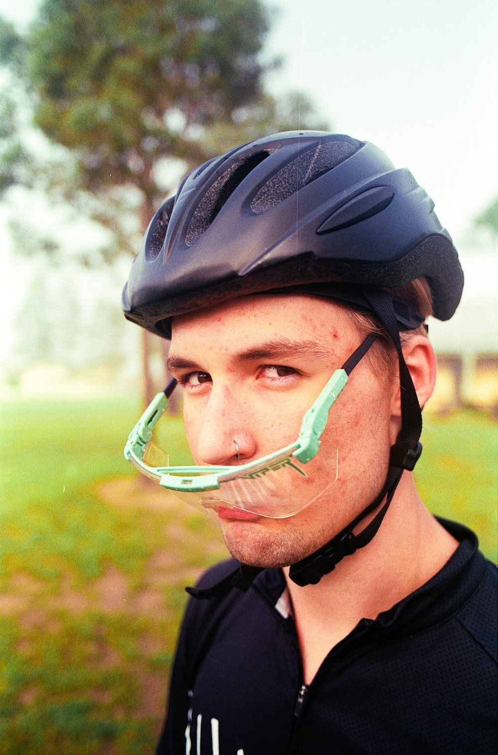man wearing black bicycle helmet