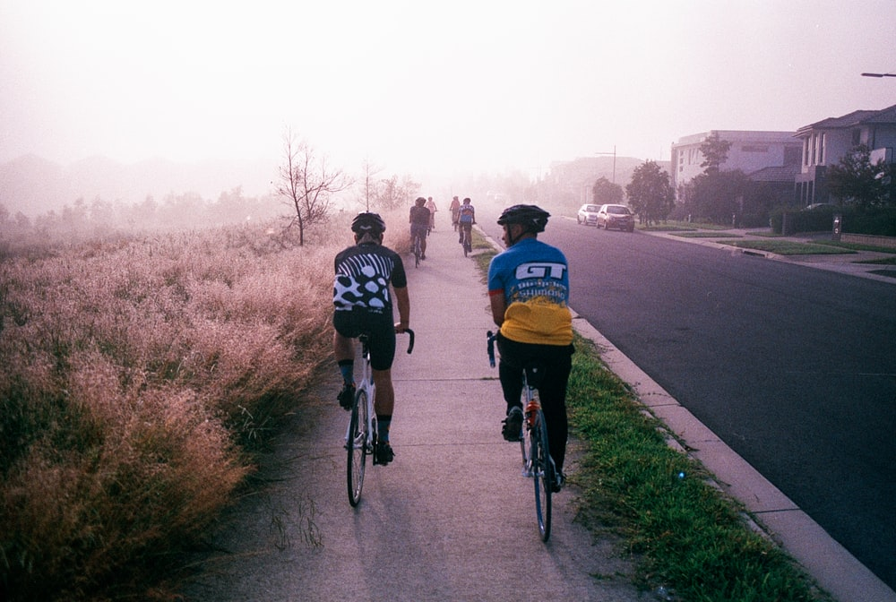 people riding road bike
