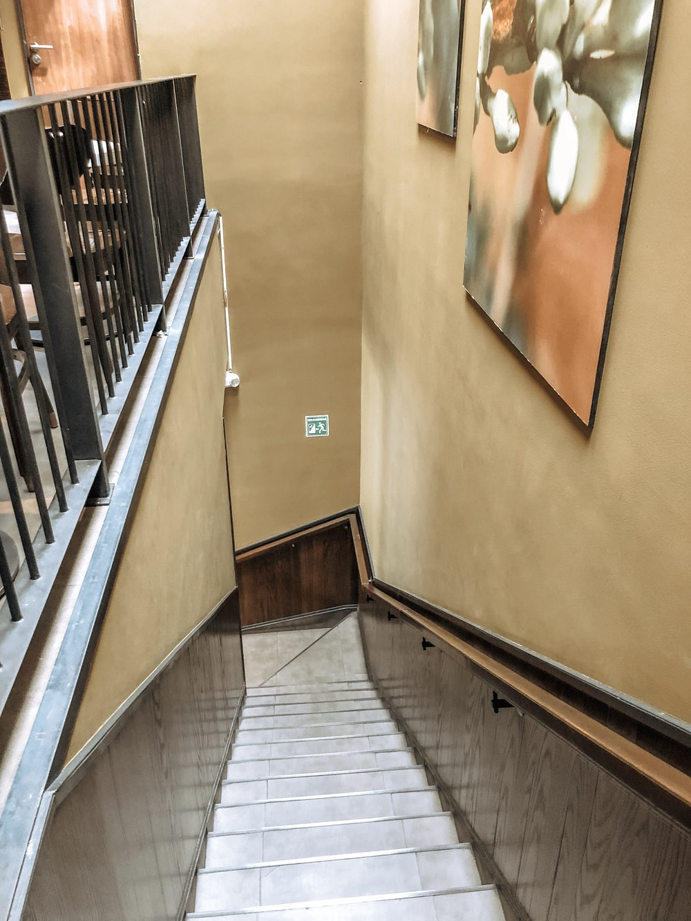empty stairs near a painting close-up photography