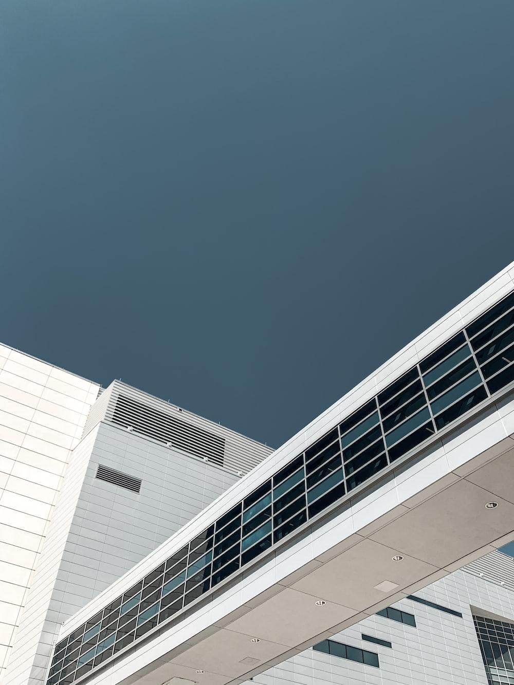 white building undr blue sky