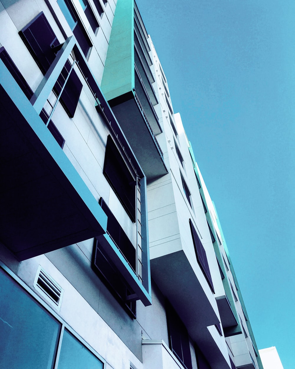 low-angle photography of white concrete building