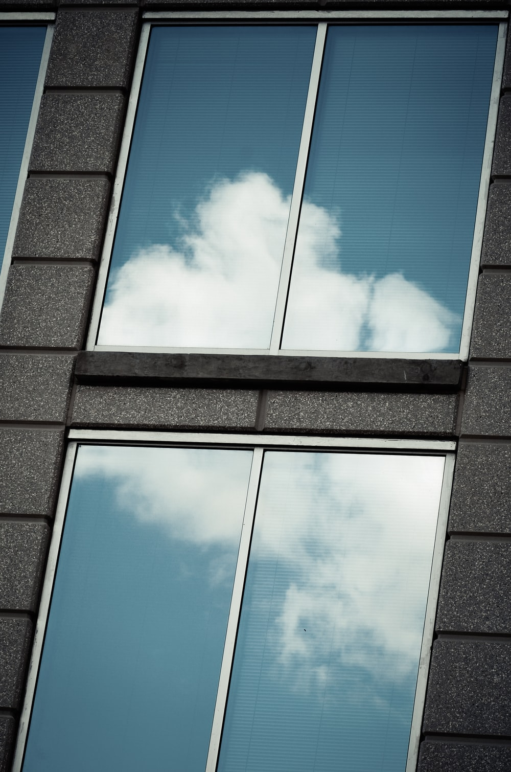 gray metal framed glass window during daytime