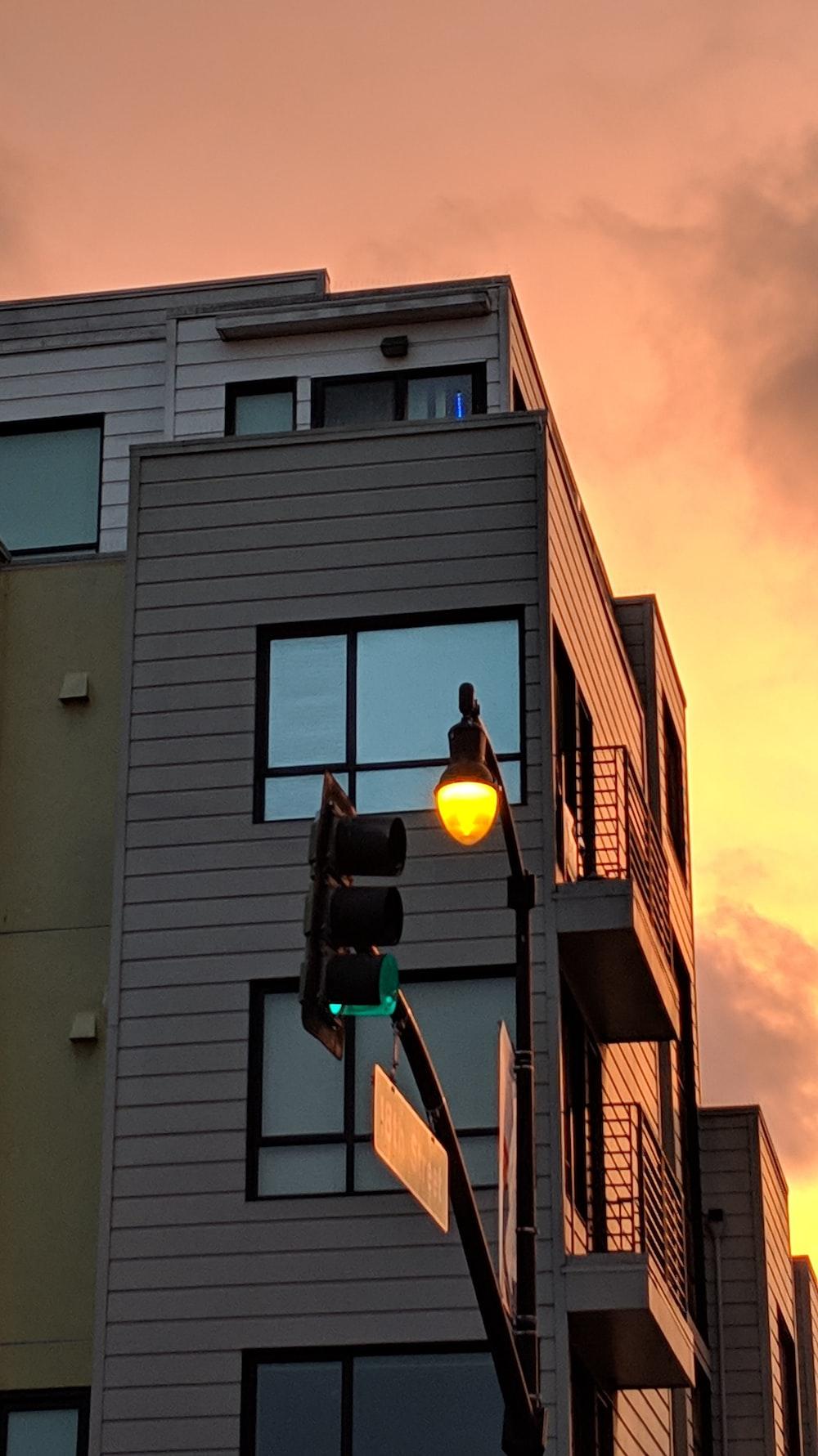 traffic lights near white building