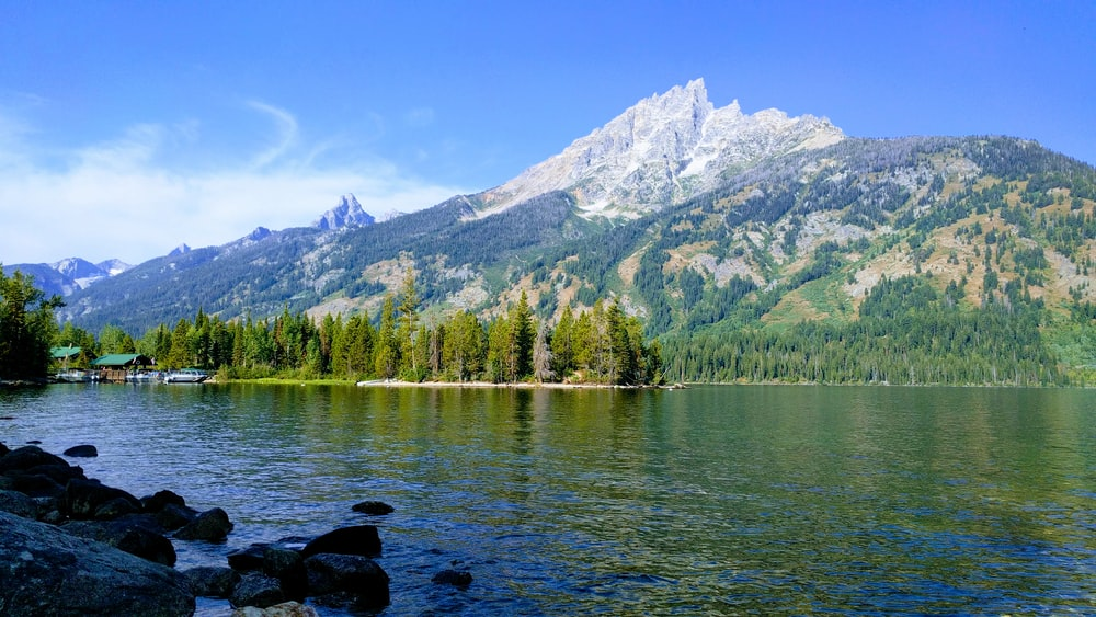 river near mountain during daytime