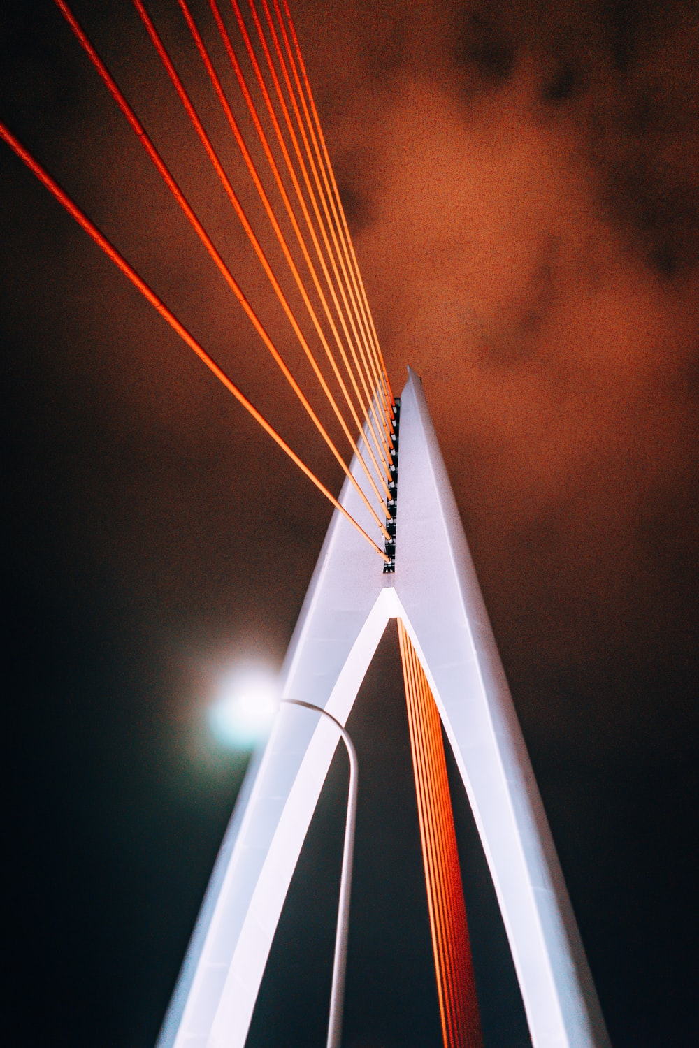 white concrete bridge with lighted lamp post during nighttime