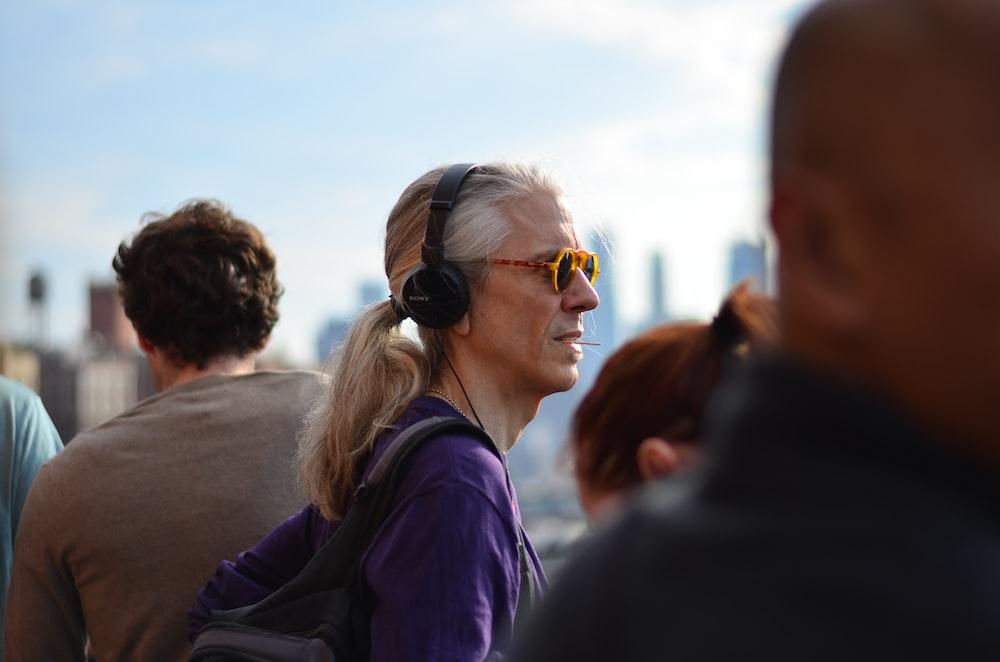person wearing purple jacket and headphones