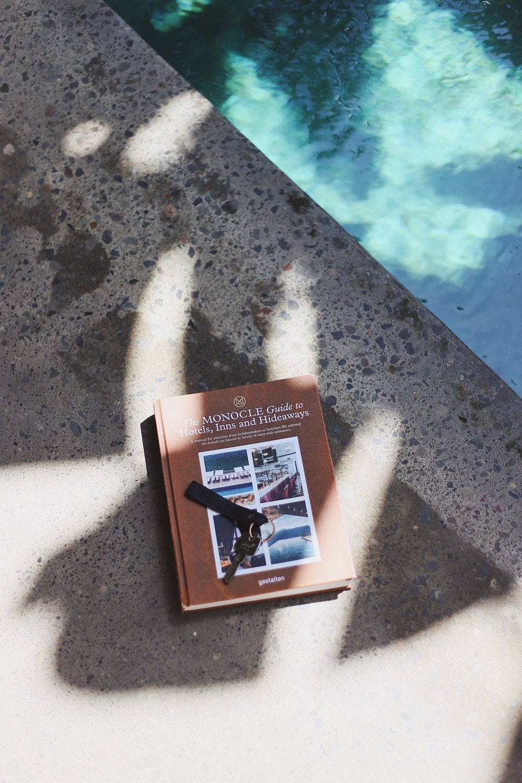 gray key on brown book