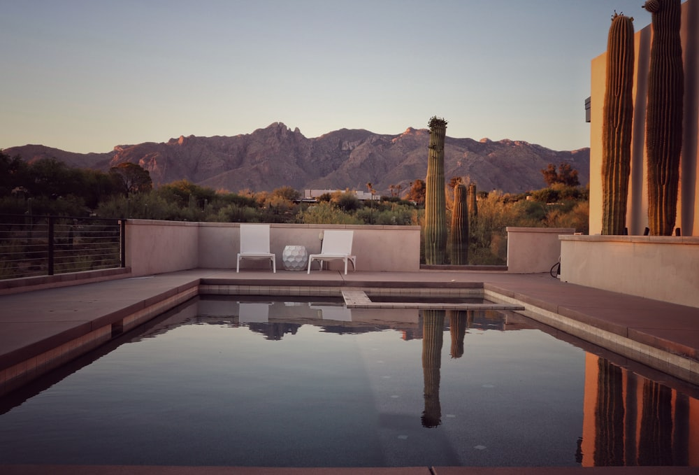 gray concrete swimming pool