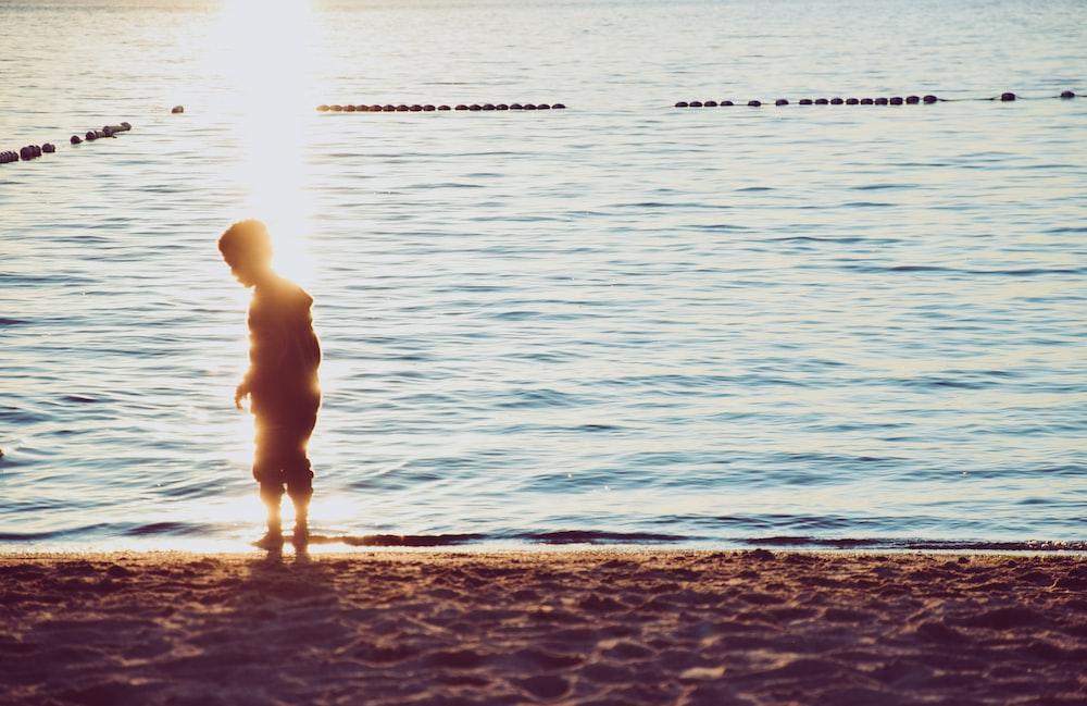 child standing in beach