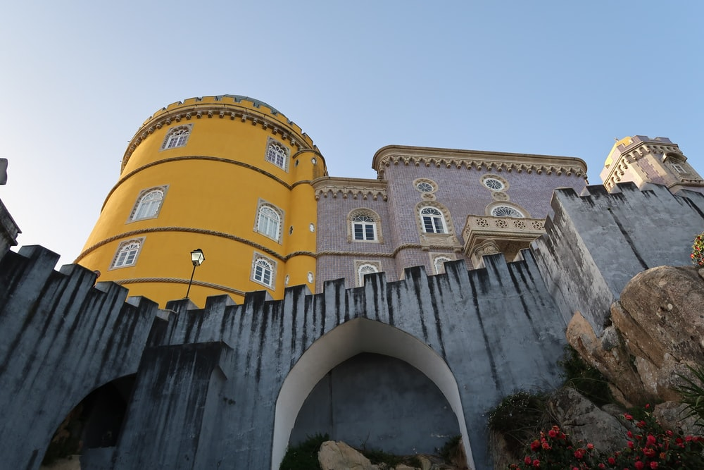 brown and yellow castle low angle photography