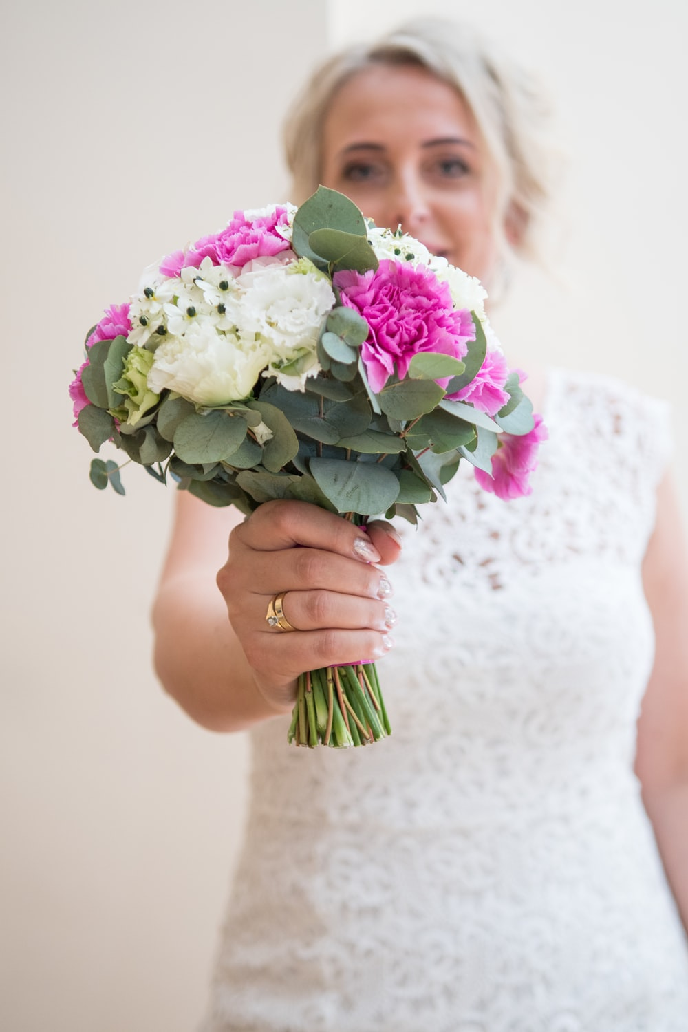 woman holding white and pink bouquet