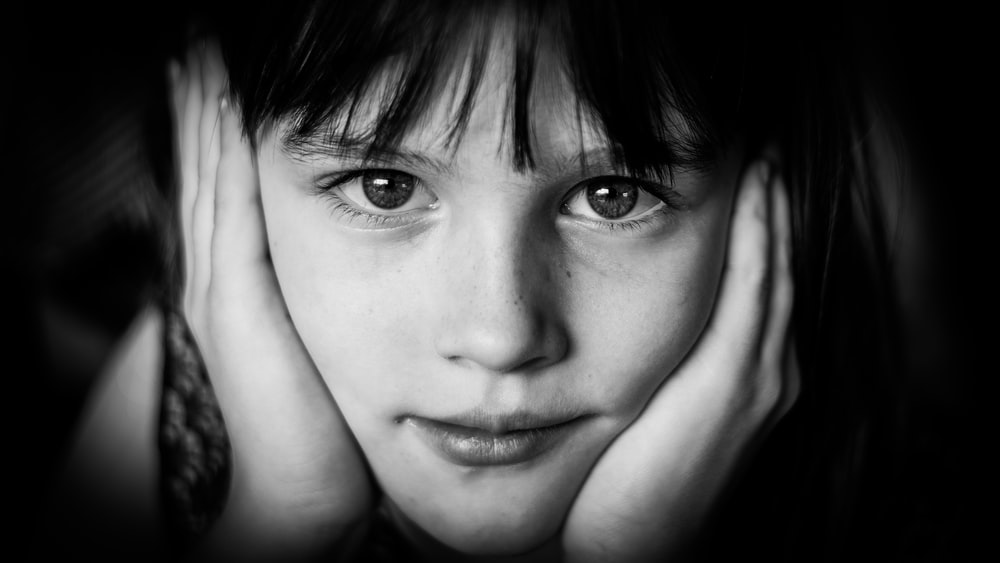 girl's face in grayscale photo