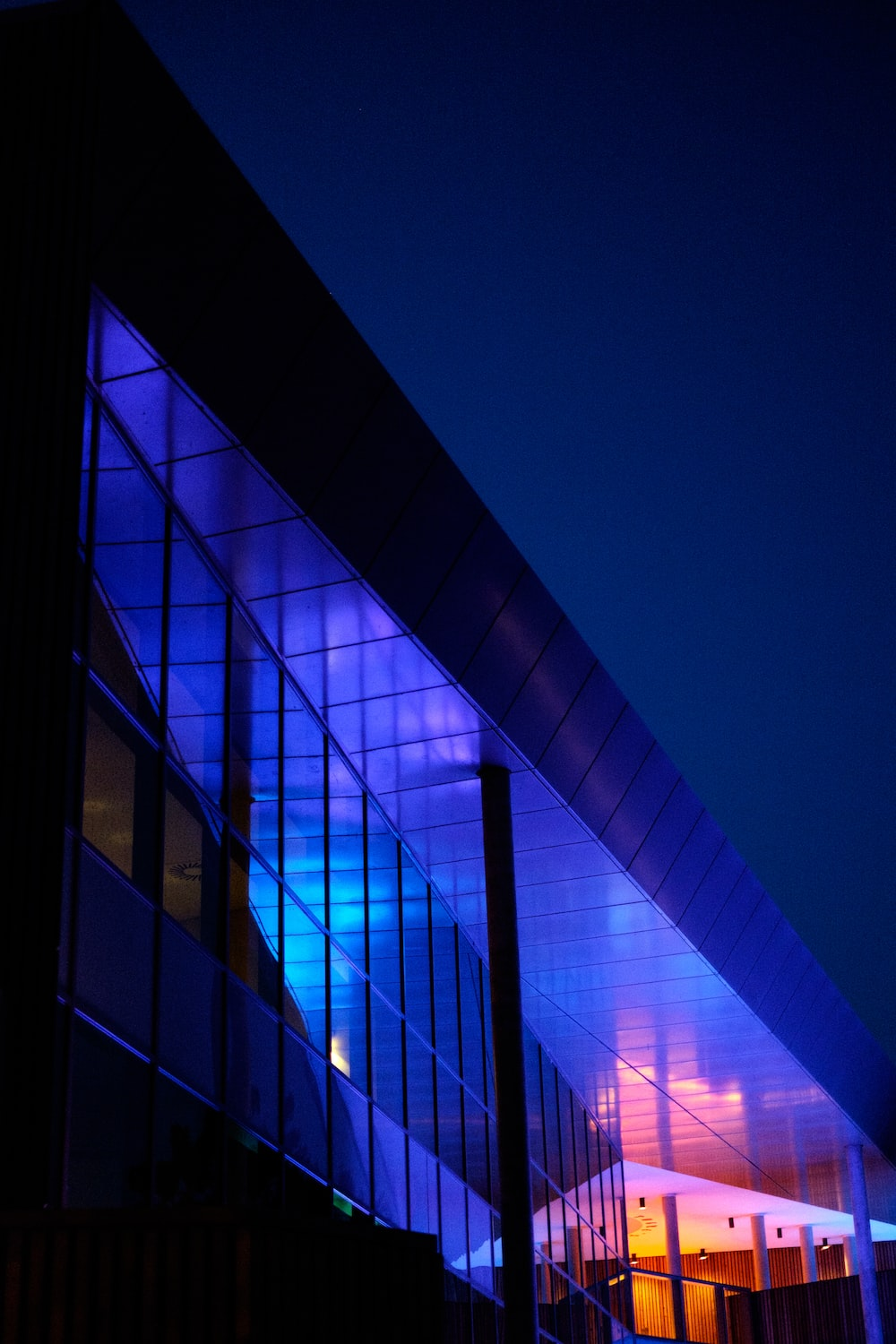 lighted gray building during night
