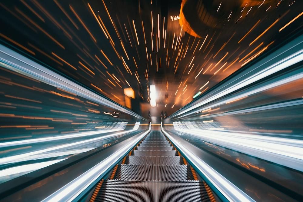 lighted grey escalator