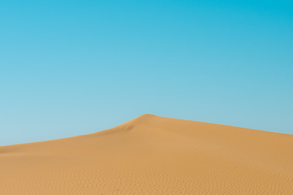 photo of brown sand dunes