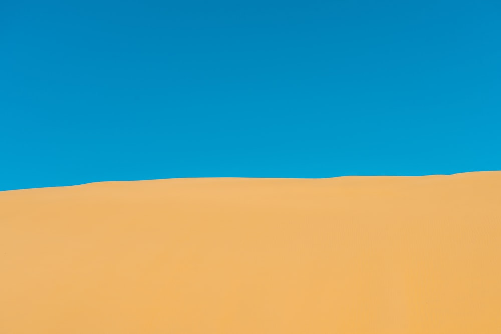 photo of brown sand dunes during daytime
