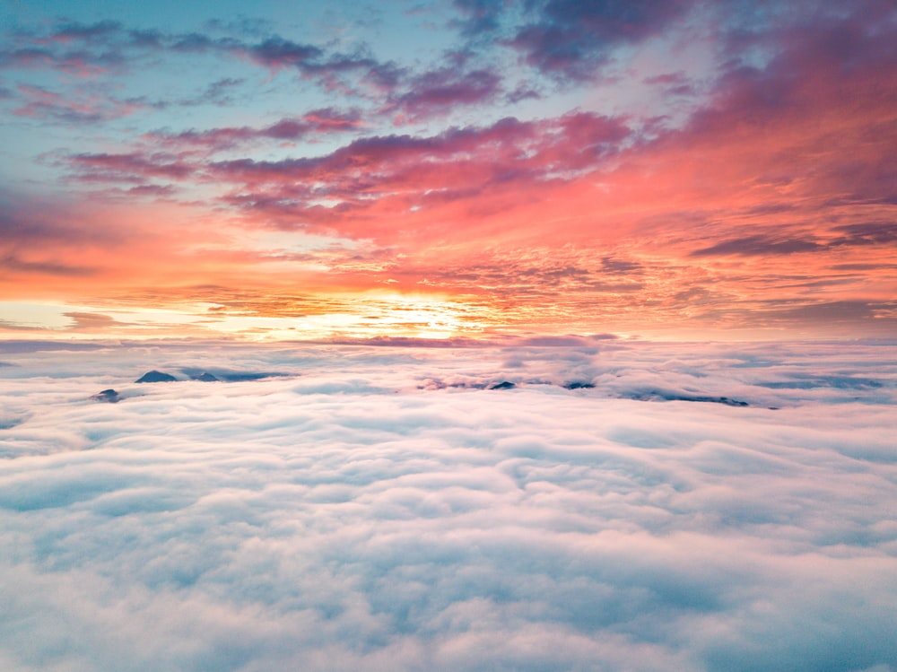 photo of a sunset above clouds