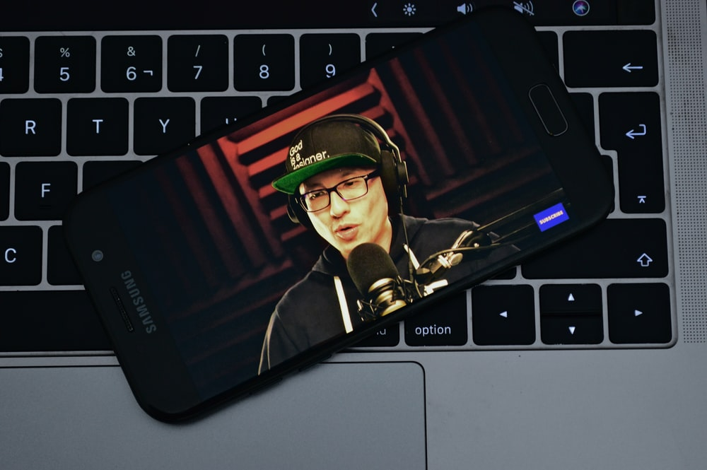 black Samsung Galaxy smartphone on grey laptop