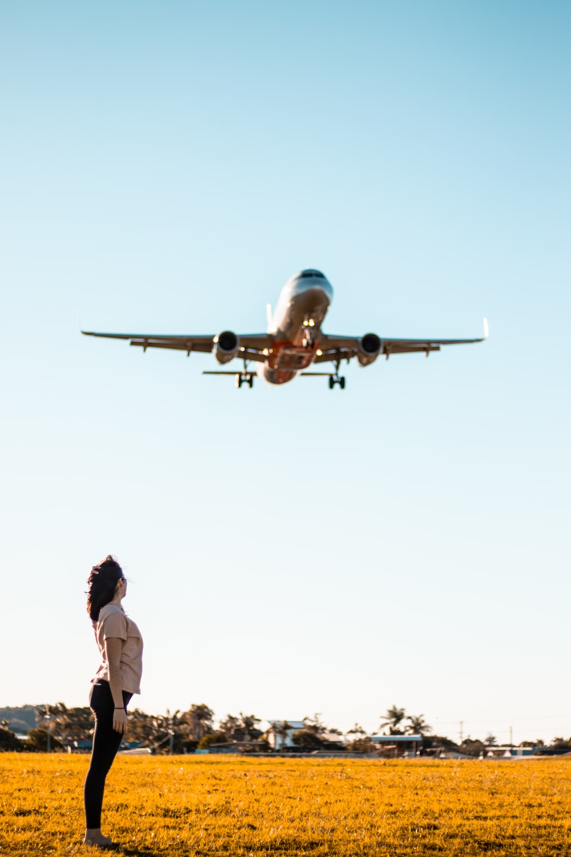 woman under airplane