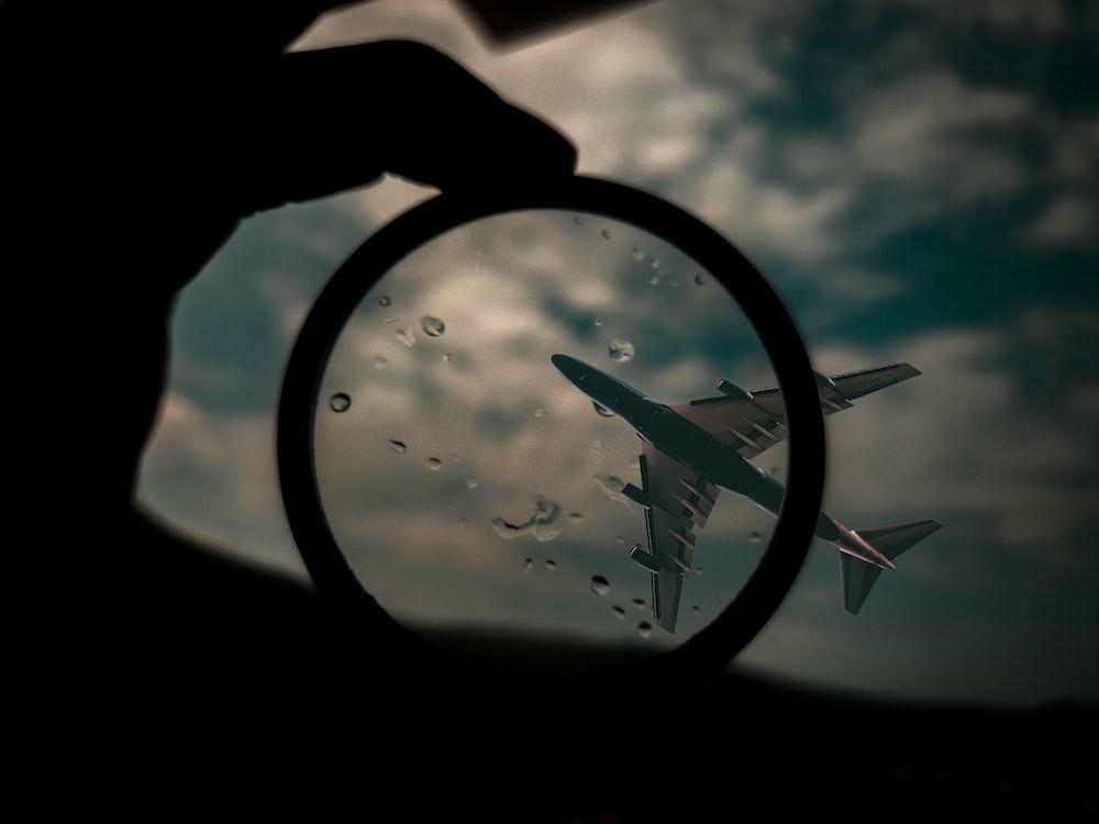 gray airplane on flight
