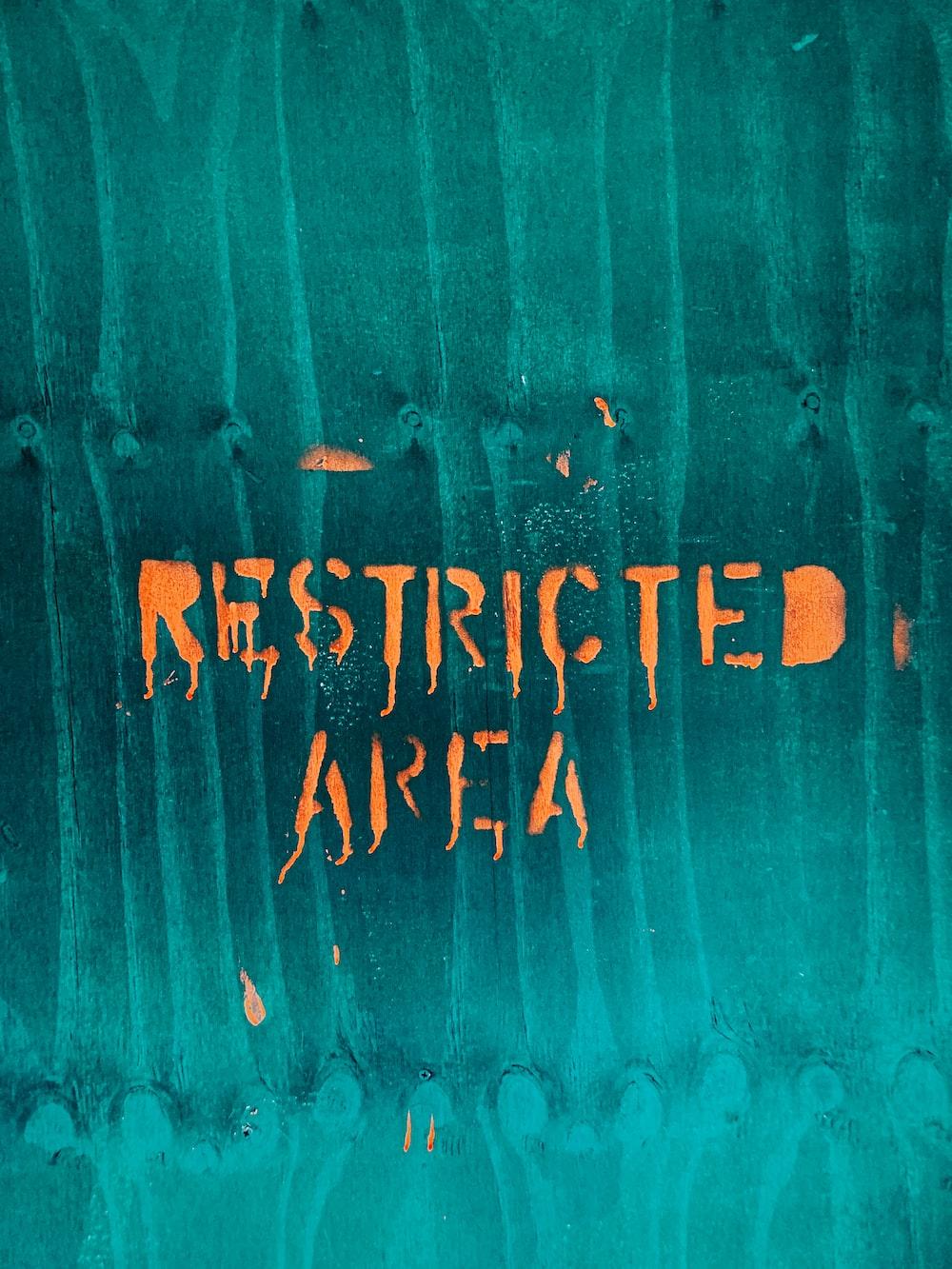 orange restricted area text