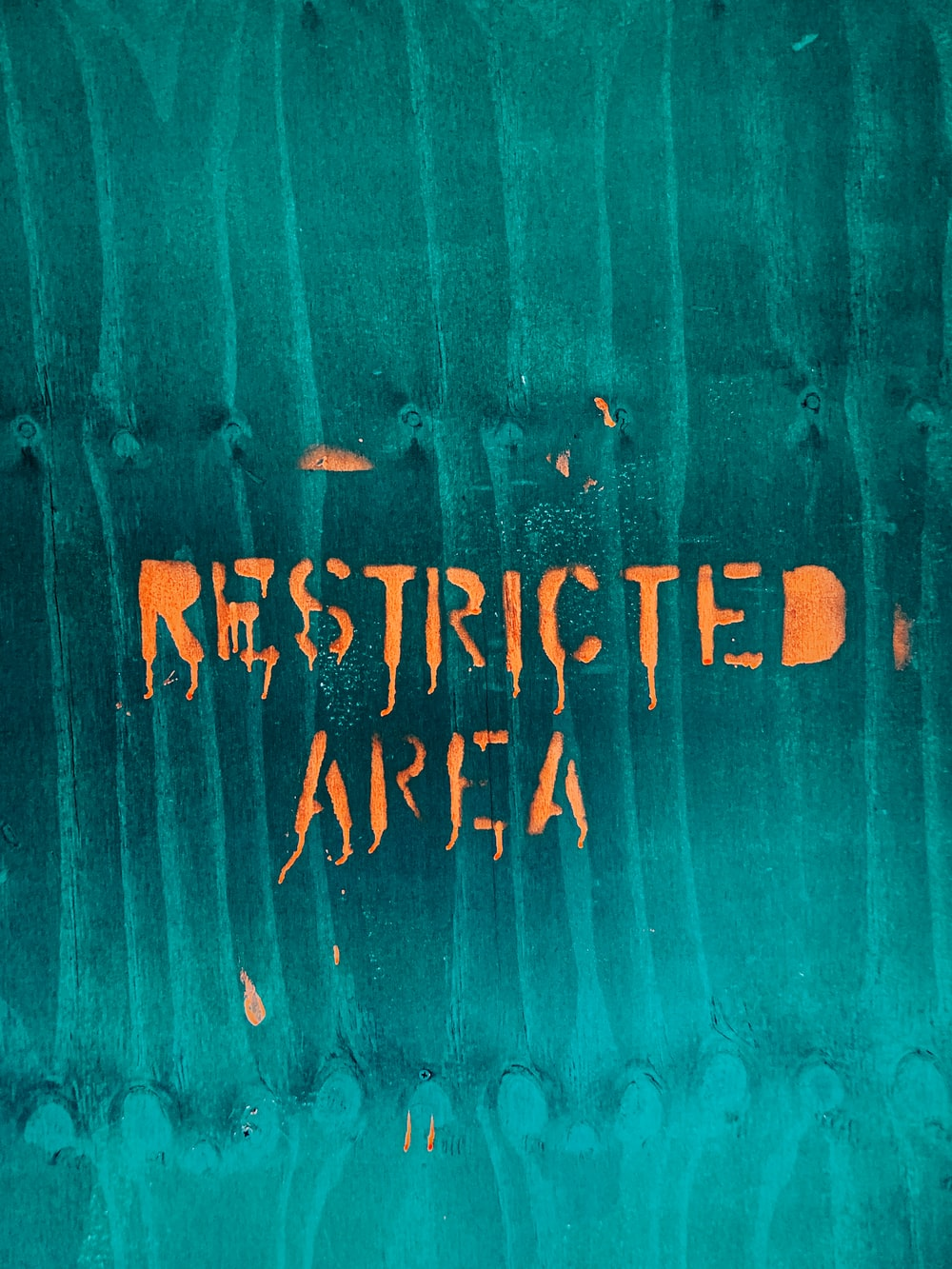 orange restricted area text
