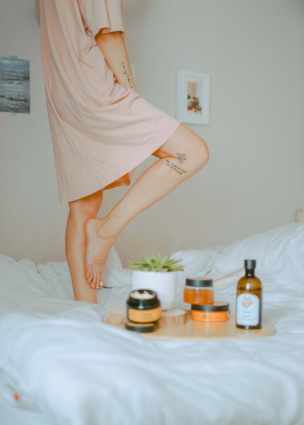 woman standing on bed