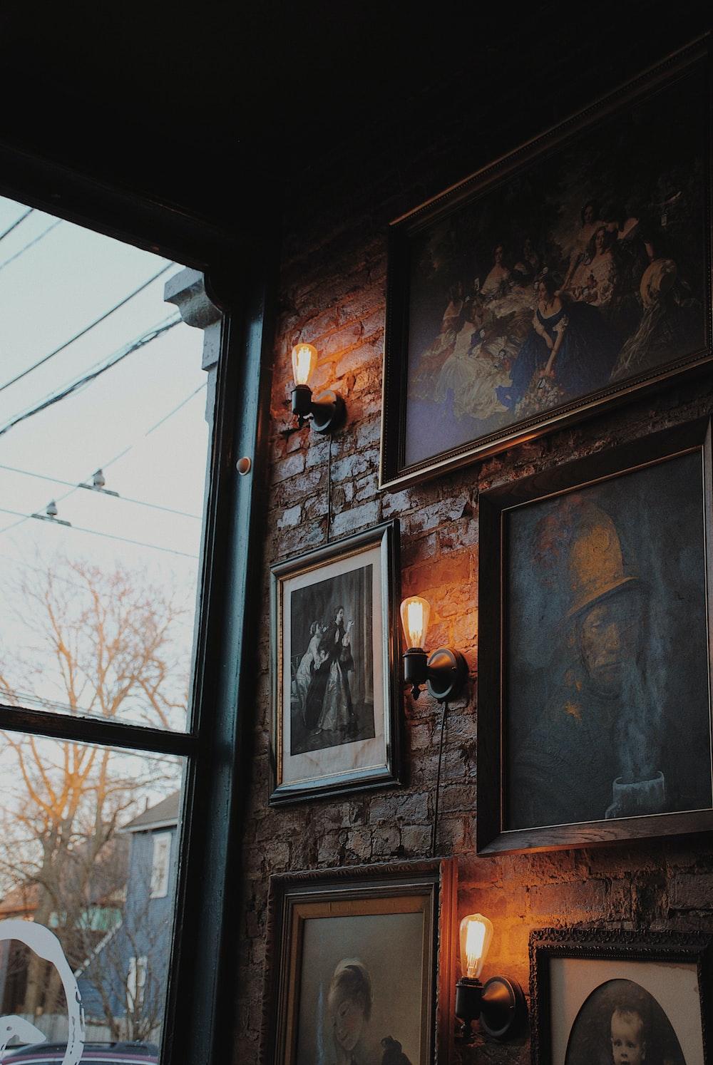 paintings on wall near window